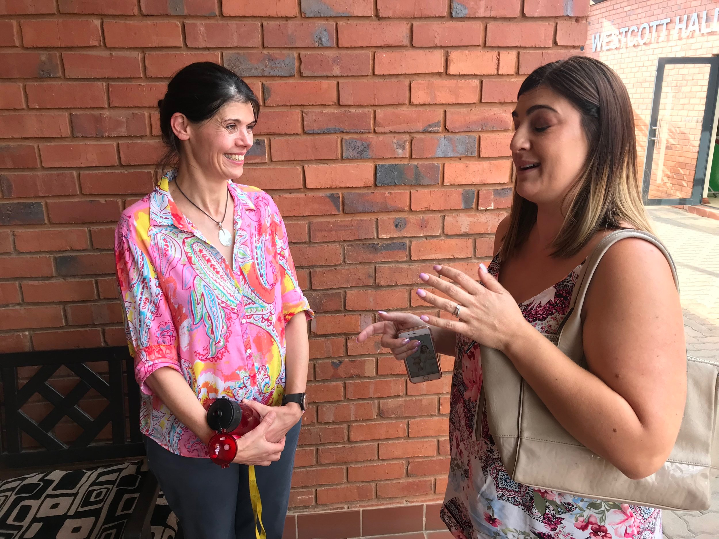 Charlene telling Annette Brokensha, MD of the Johannesburg Children's Home, about how much we swear in each of our podcast episodes. Oops.