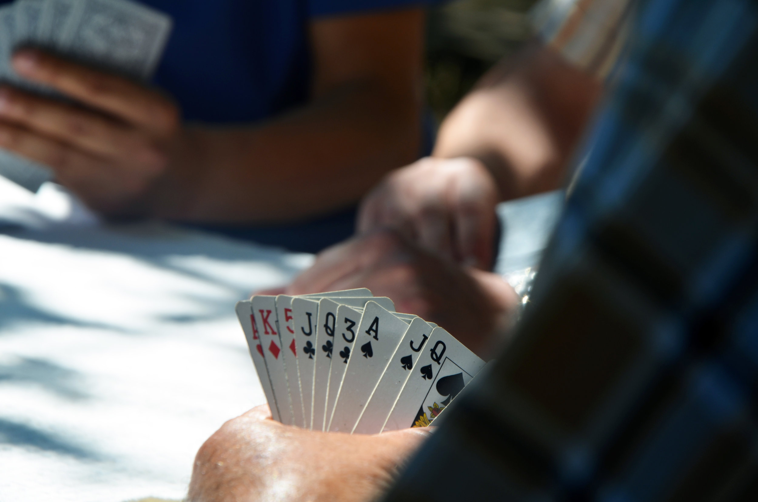 A hand of cards representing the gaming and casino industry that uses Ethnic Technologies' products