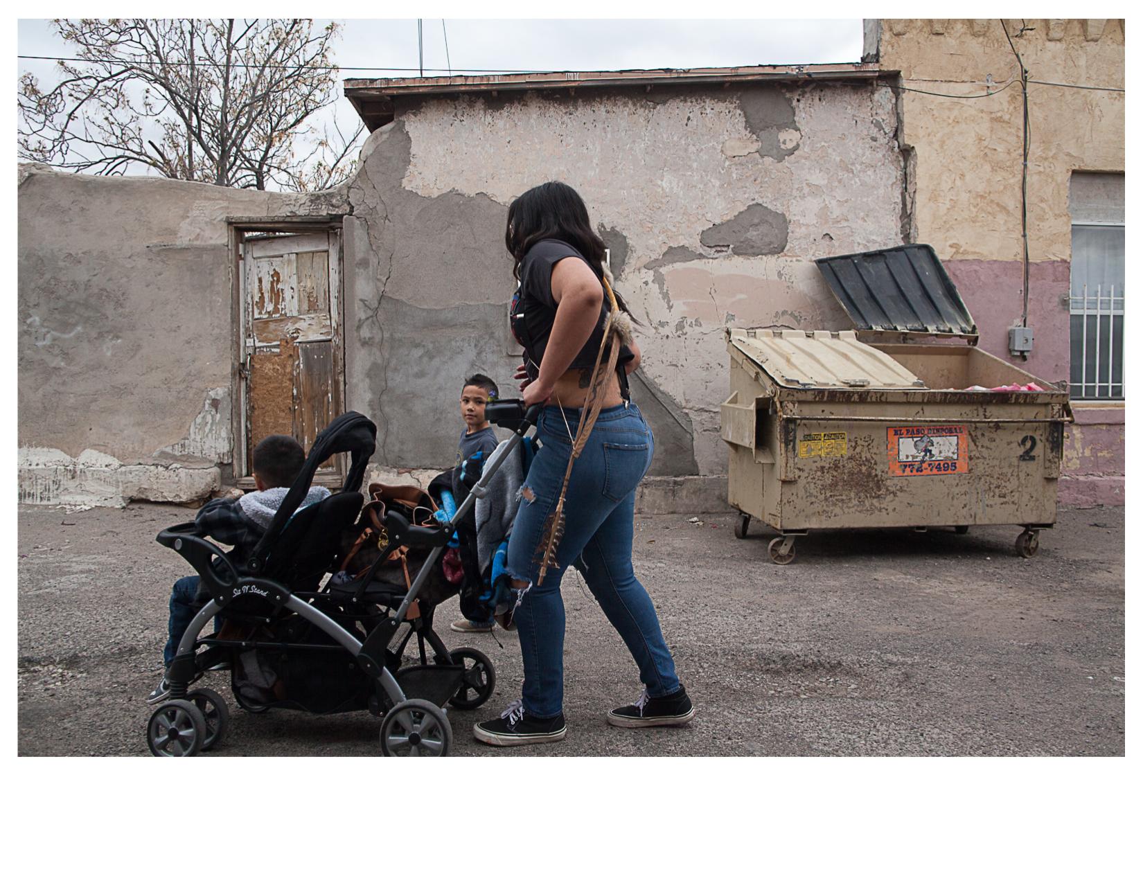 Family in Alley, El Segundo Bario, TX