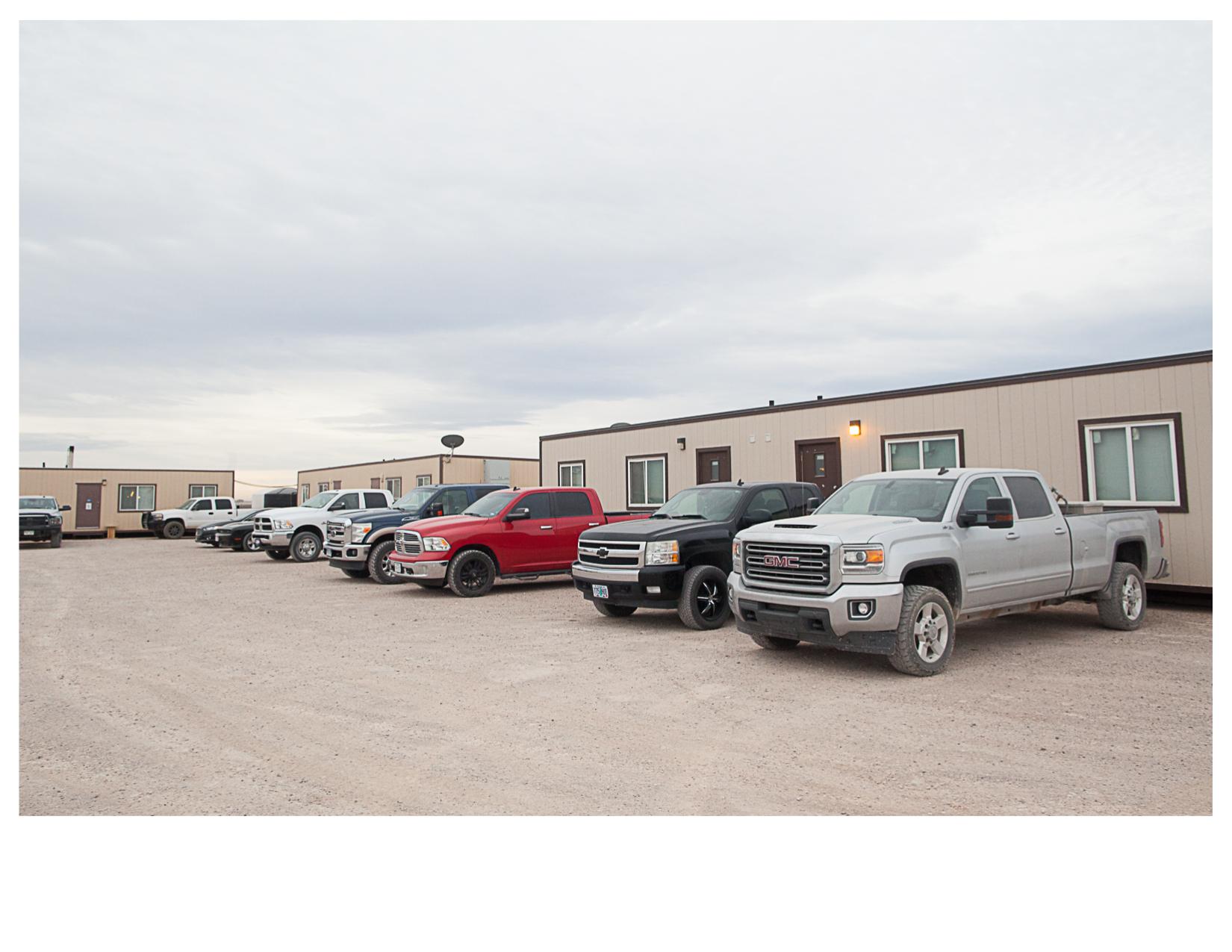 Pickup Trucks outside Oilfield Worker's Trailers, Pecos, TX