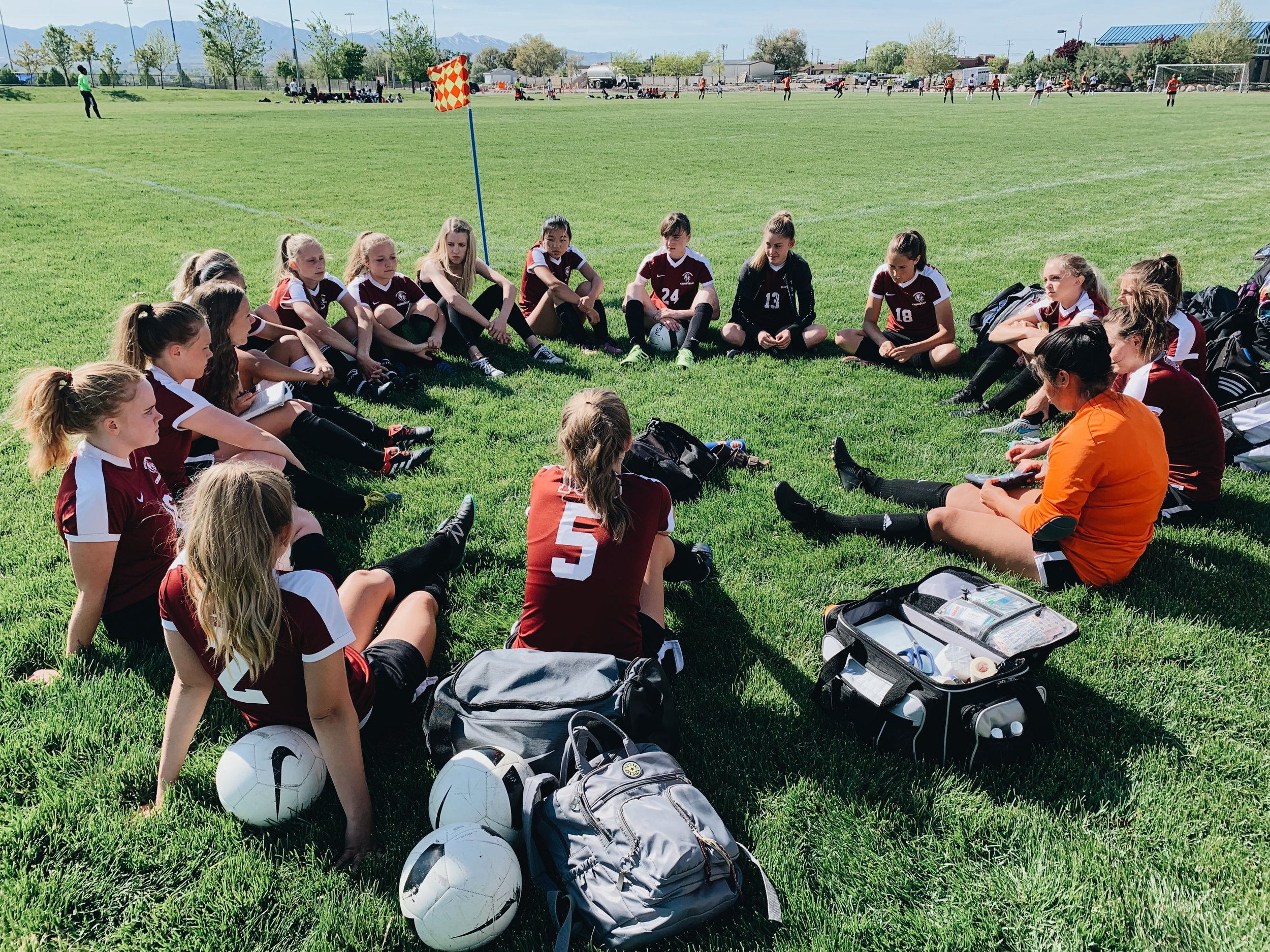 ICS Women's Soccer Team doing Team Devotions before the State Final game