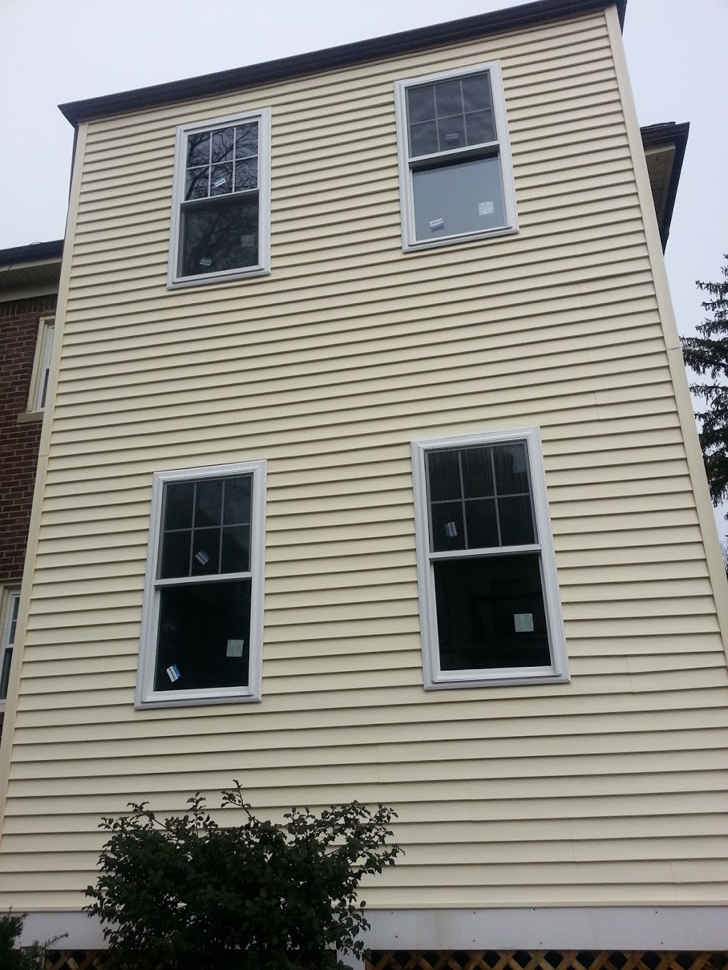 Rebuild and enclosure of porch with siding.