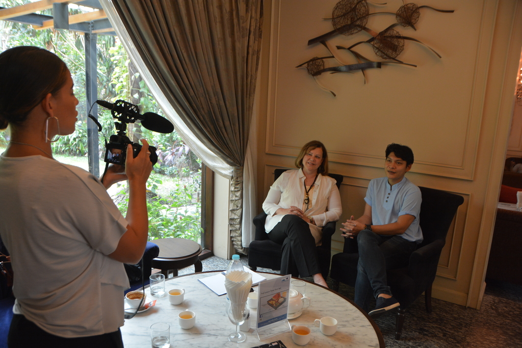 Sharon and Myanmar filmmaker Sein Lein, discussing the importance of changing culture through film.