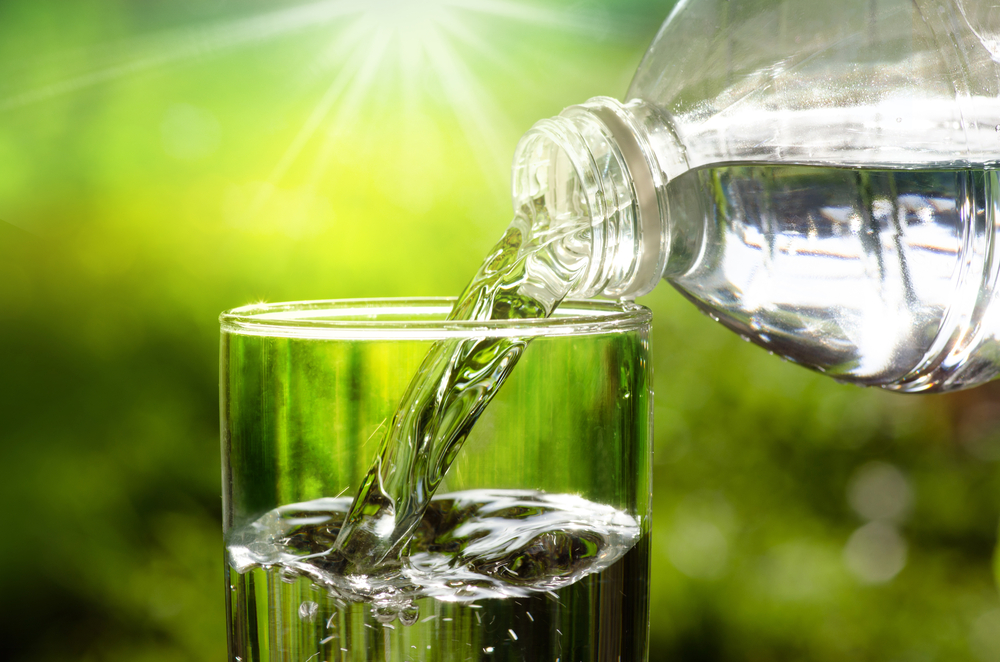 water bottle pouring in glass.jpg