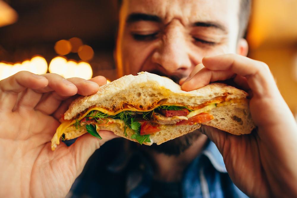 Man eating sandwich.jpg