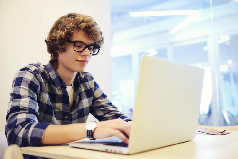 collge boy typing.jpg