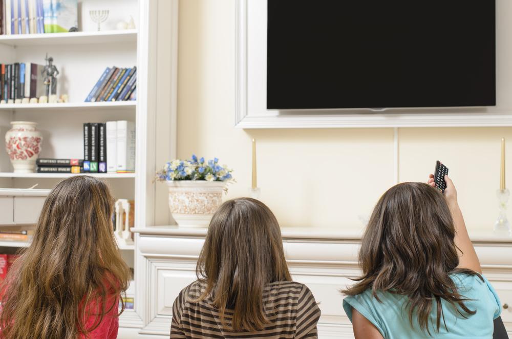 young women watching tv.jpg