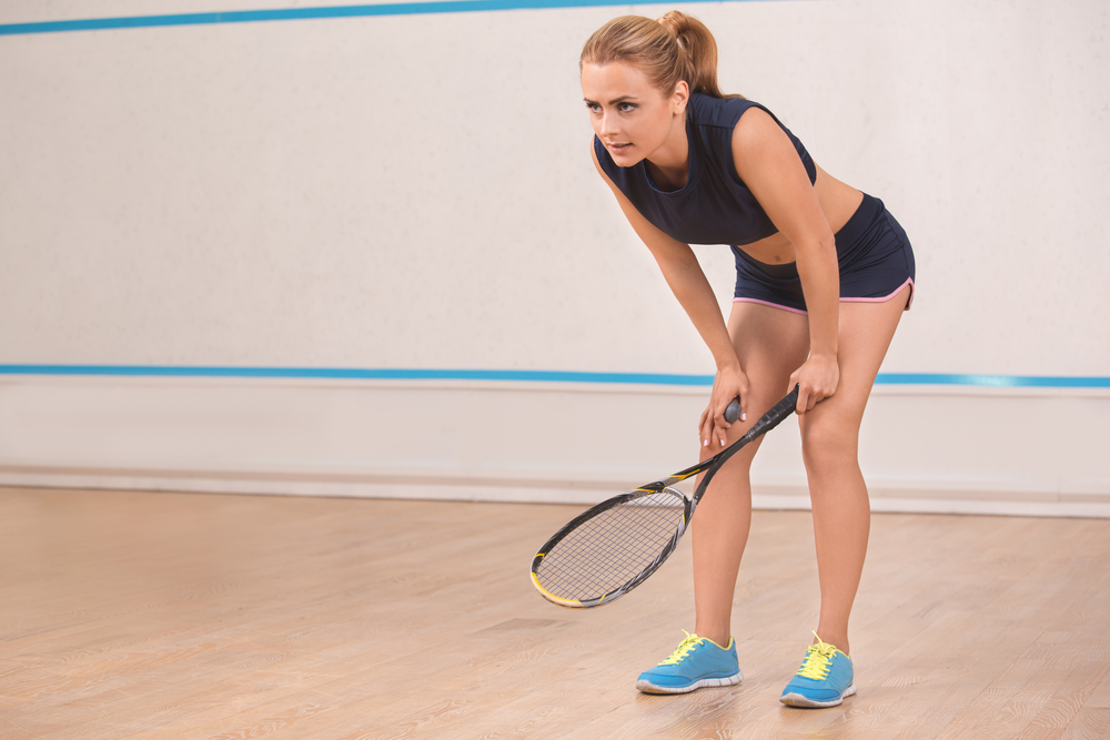 young woman playing squash_UT Austin_rec centers.jpg