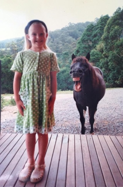 horse photobombing little girl.jpg