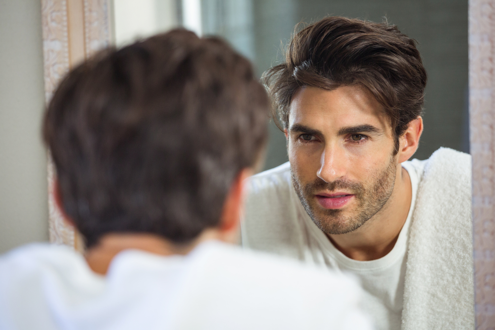 man looks at himself in mirror.jpg