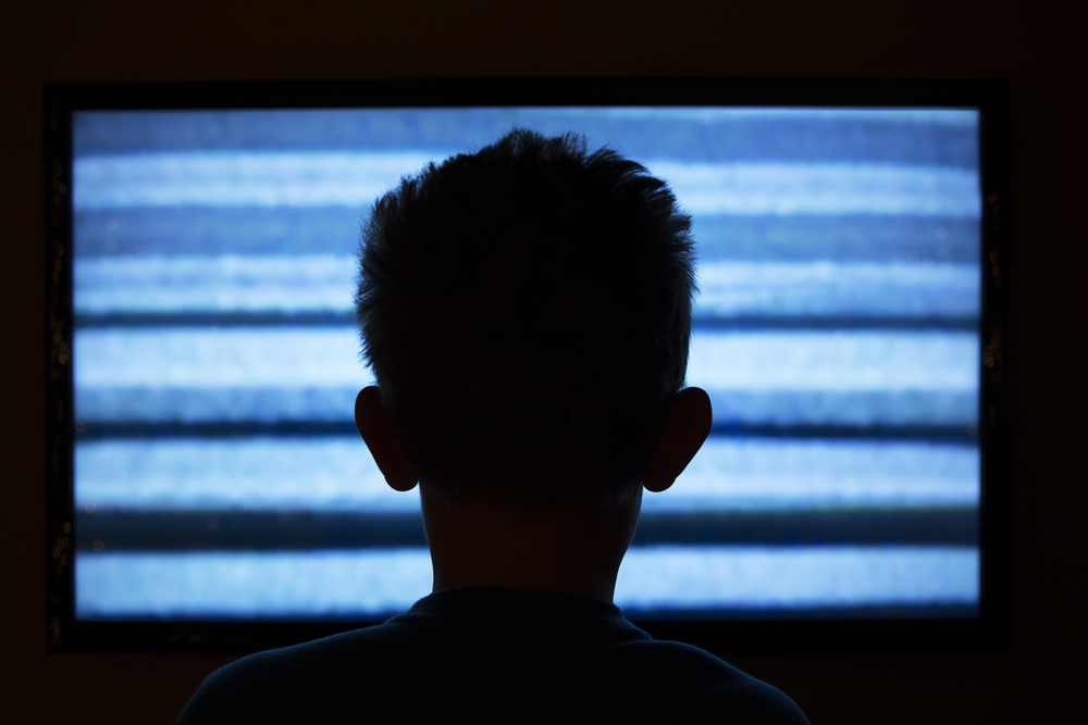 boy watching tv.jpg