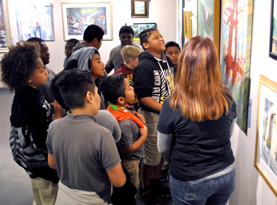 Bright young men from Visible Men Academy discuss their favorite works during their Slice of Art field trip.