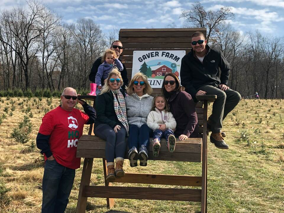 The Lines Family in 2018: Ken Lines (standing), Brittney Hogan, Kris Lines, Zoe Lines, Ashley Lines, Nick Hogan, and, in the back, Scarlett Lines and Brad Lines