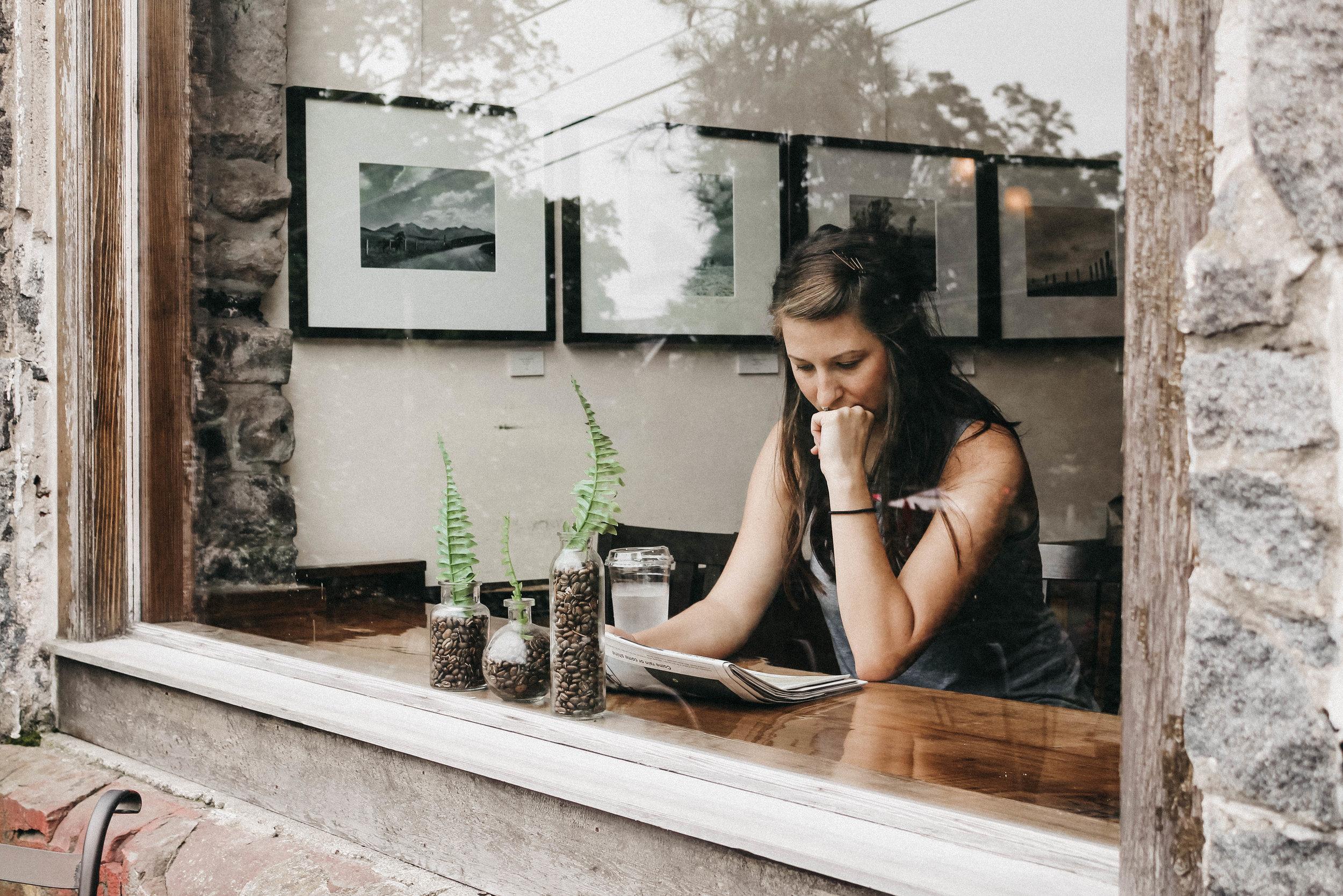 brigodoon coffeehouse woman drinking coffee in window.jpg