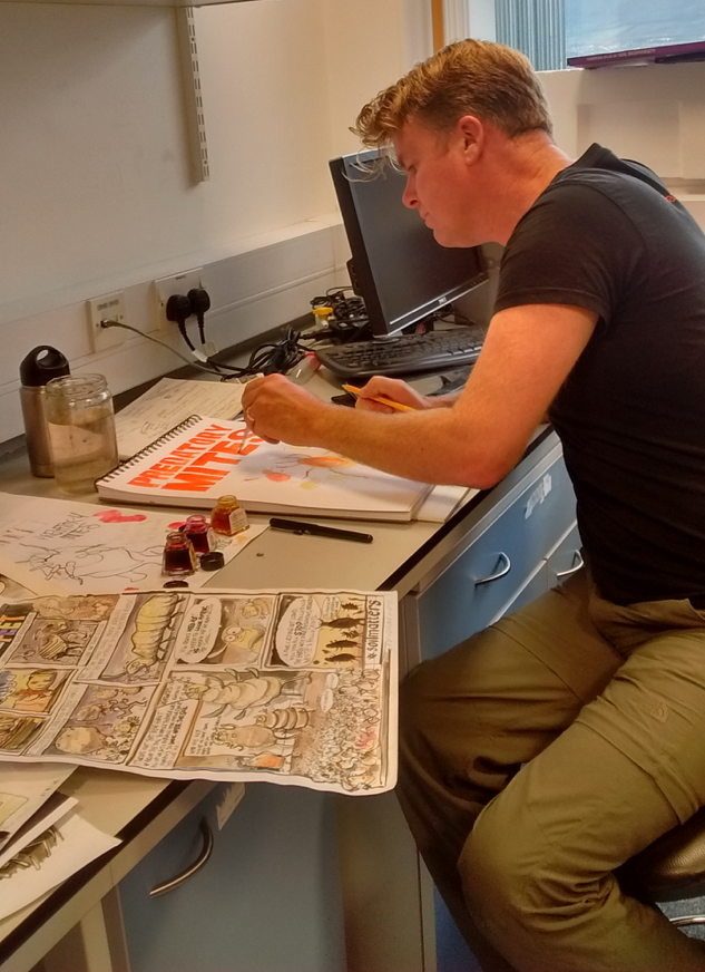 Artist Ed Reynolds at work. Photo credit: T. Caruso