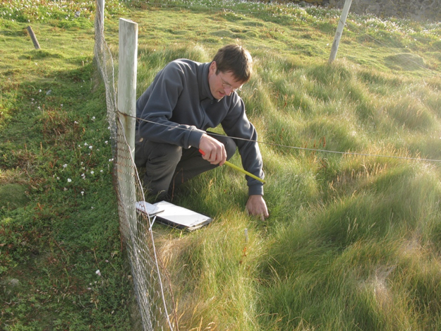 Rene van der Wal, ecologist at University of Aberdeen, surveys the plant community on Isle of May. Photo by: Walter Andriuzzi