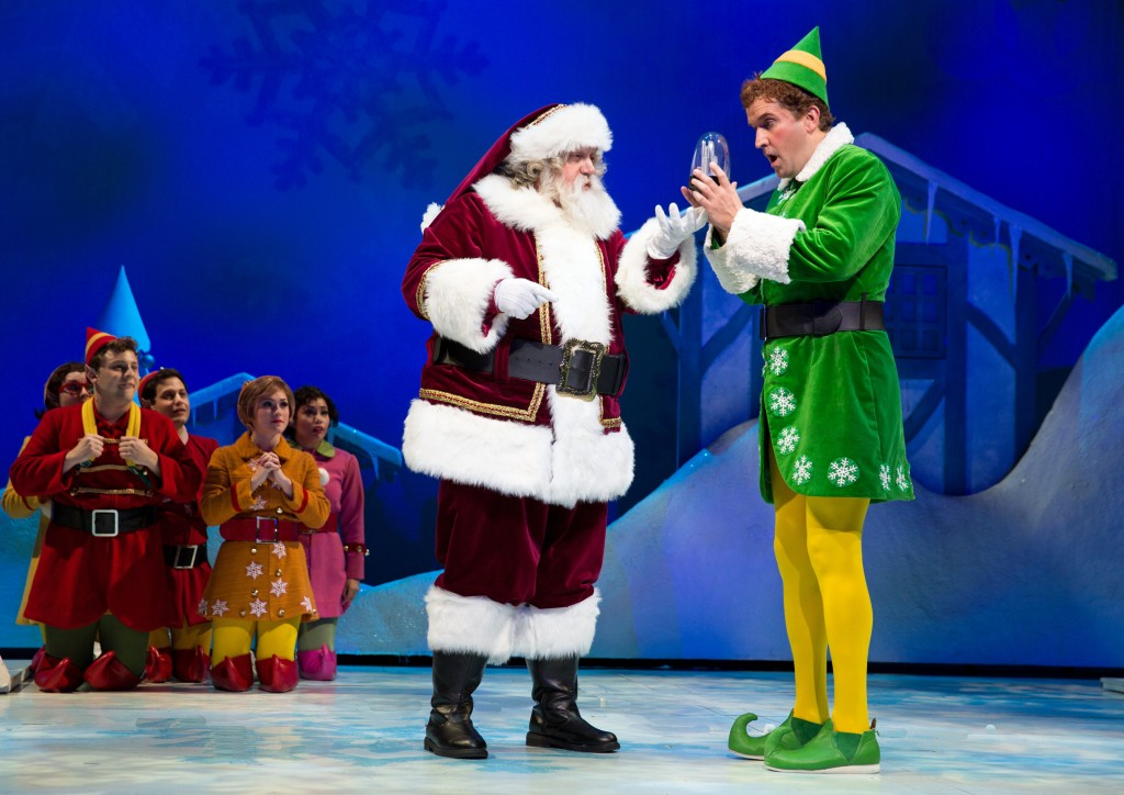Elf at Paper Mill Playhouse; Photo by Matthew Murphy; Form left to right: Paul C. Vogt (Santa) and James Moye (Buddy) with Santa's Elves.