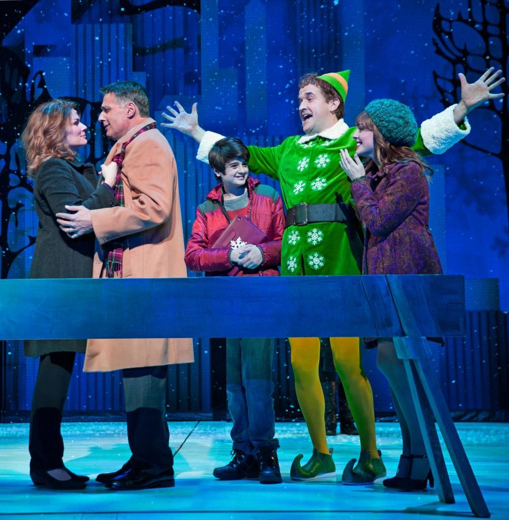 Elf at Paper Mill Playhouse; Photo by Matthew Murphy; From left to right: Heidi Blickenstaff (Emily Hobbs), Robert Cuccioli (Walter Hobbs), Jake Faragalli (Michael Hobbs), James Moye (Buddy) and Kate Fahrner (Jovie).