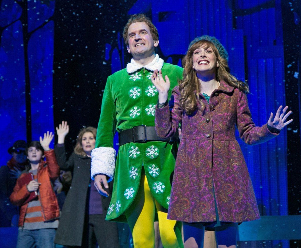 Elf at Paper Mill Playhouse; Photo by Jerry Dalia; From left to right: Jake Faragalli (Michael Hobbs), Heidi Blickenstaff (Emily Hobbs), James Moye (Buddy) and Kate Fahrner (Jovie).