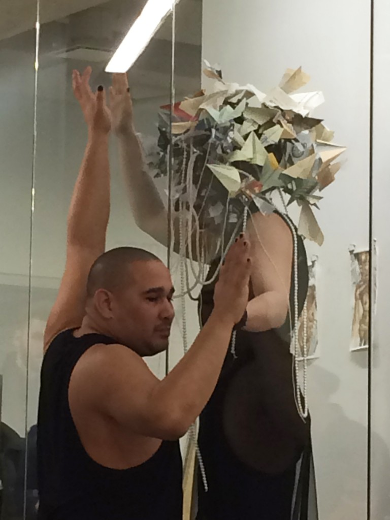 "A performance in The Window gallery featuring artist David Antonio Cruz and singer Janetza Maria Miranda. The performance was arranged by curator Kevin Darmanie who organized the exhibition ""Our Anxious Times""."