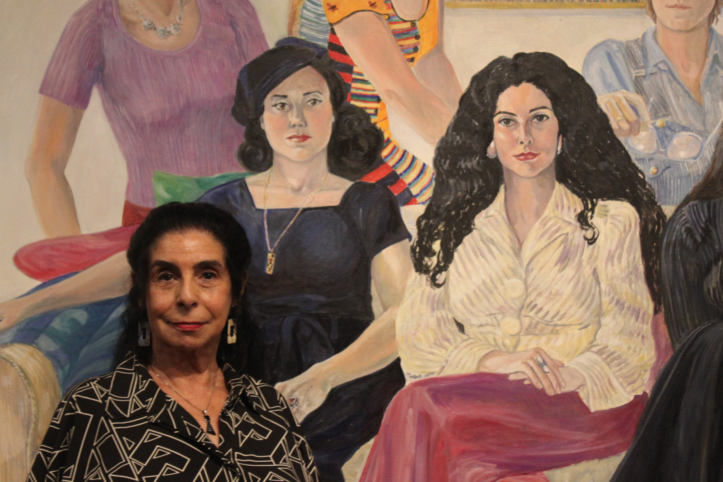 "Cynthia Mailman, (b. 1942), in front of Sylvia Sleigh's ""SOHO 20 Group Portrait,"" 1974, oil on two canvases."