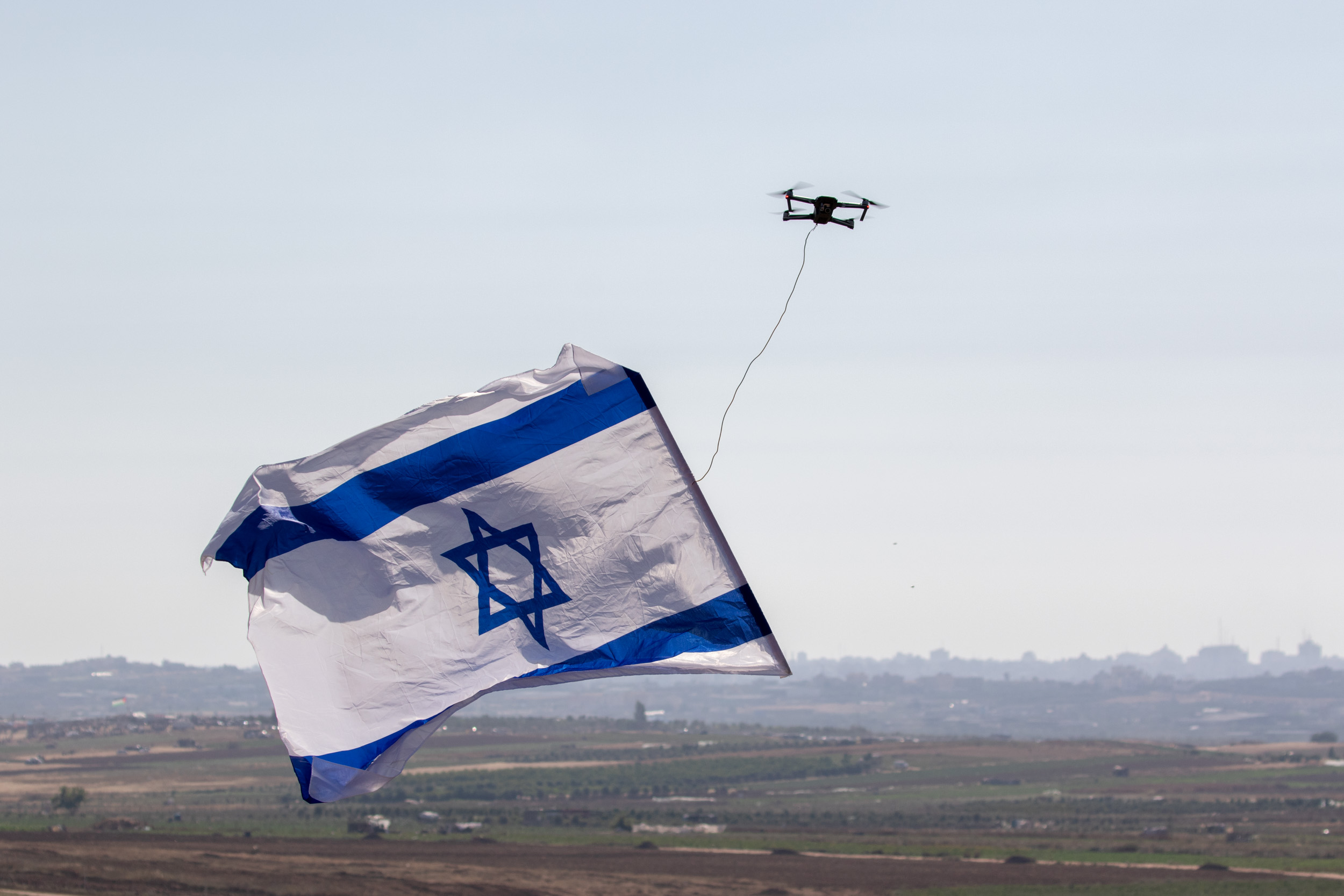 Northern Gaza Border, June 2018 - Small drone carries the israeli flag, sent by Israelis leaving near the gaza border