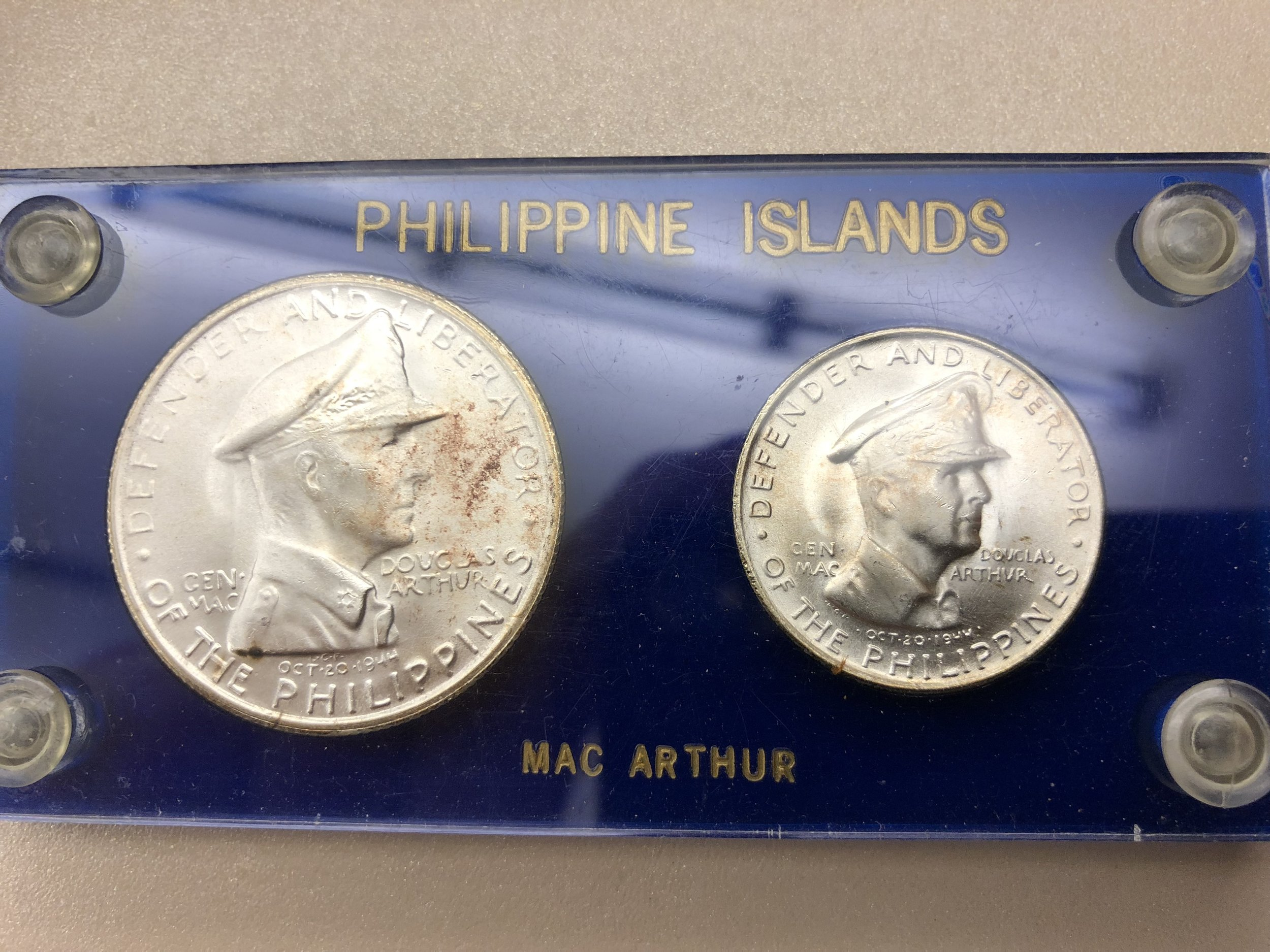 Reverse has figure of General Douglas MacArthur Defender and Liberator of the Philippines.  Small print date Oct. 20, 1944.
