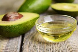 2. Brush on some oil. - Oil will help oxygen from reaching the flesh of an avocado. Brush the exposed area with olive or vegetable oil to create a barrier, then , with the pit still in place, wrap tightly with plastic wrap and seal in an airtight container—it should keep from browning for about a day or so.