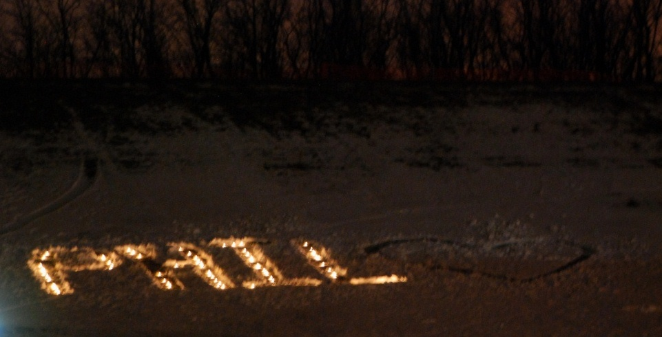 Phil_-_Tribute_with_Candles_at_Sunset_at_Fairport_High_School-resized.jpg