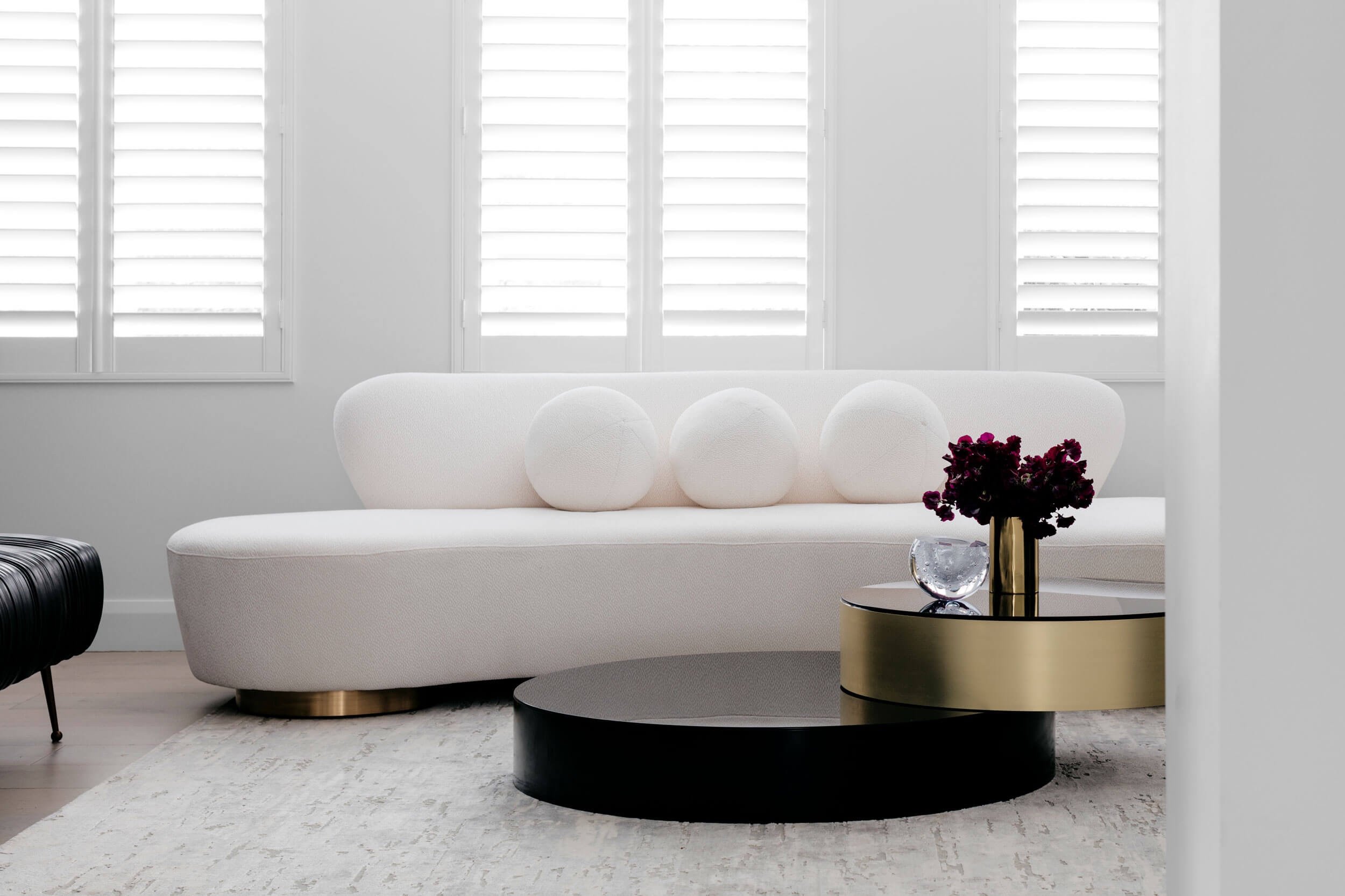 Custom curved coffee table at  Rose Bay House