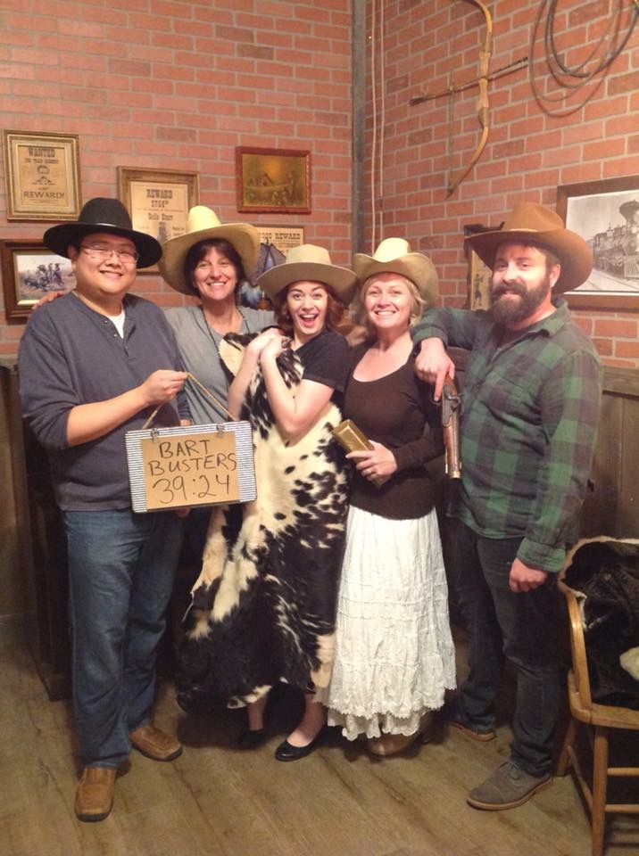 """Evan and Liz with our friends Courtney, Krista & CH (right to left) - the """"Bart Busters"""" after beating the Ramblin' Rogue escape room by Escape Ashland"""