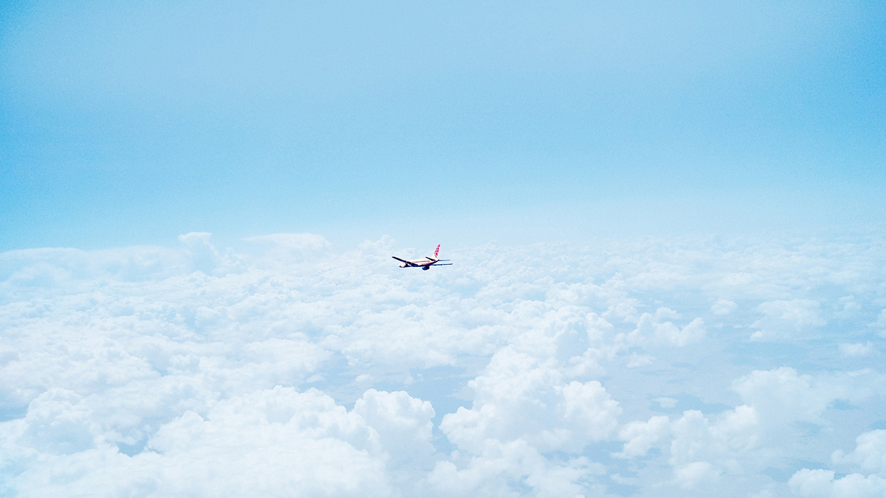 above-the-clouds-airplane-blue-512778.jpg