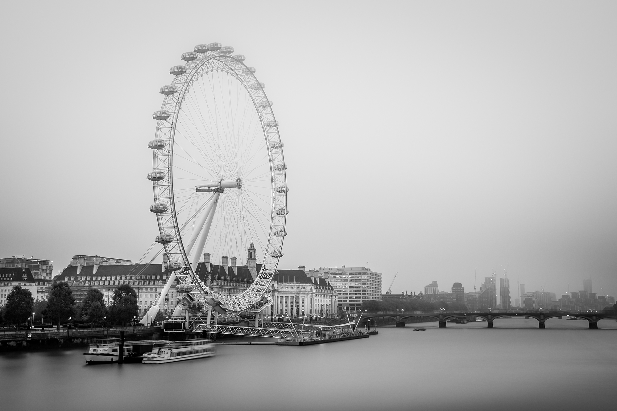 Black and White long exposure photo of the London Eye by Trevor Sherwin