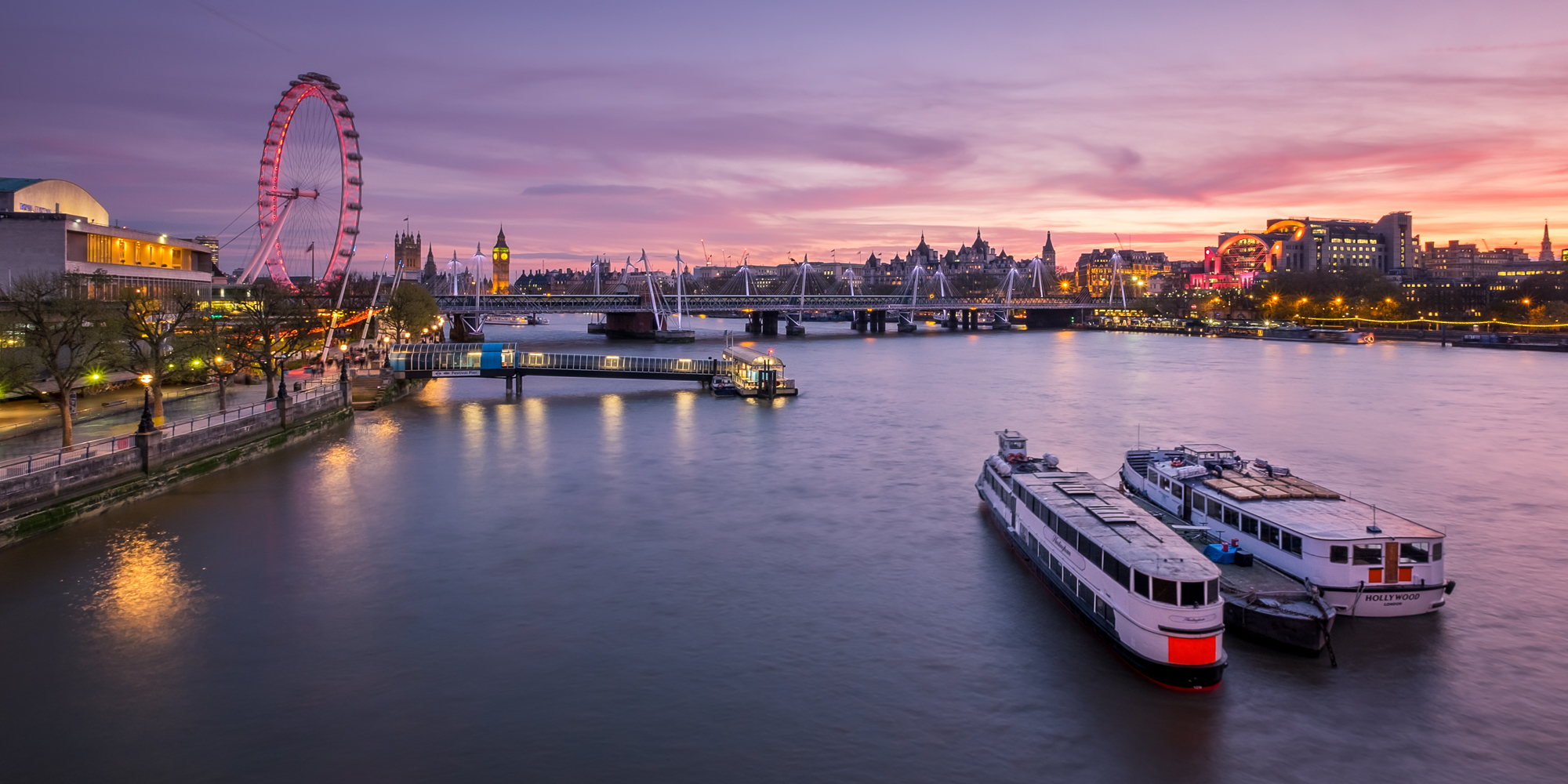 A wide angle photo of The London Eye from the Waterloo Bridge at sunset taken by Trevor Sherwin