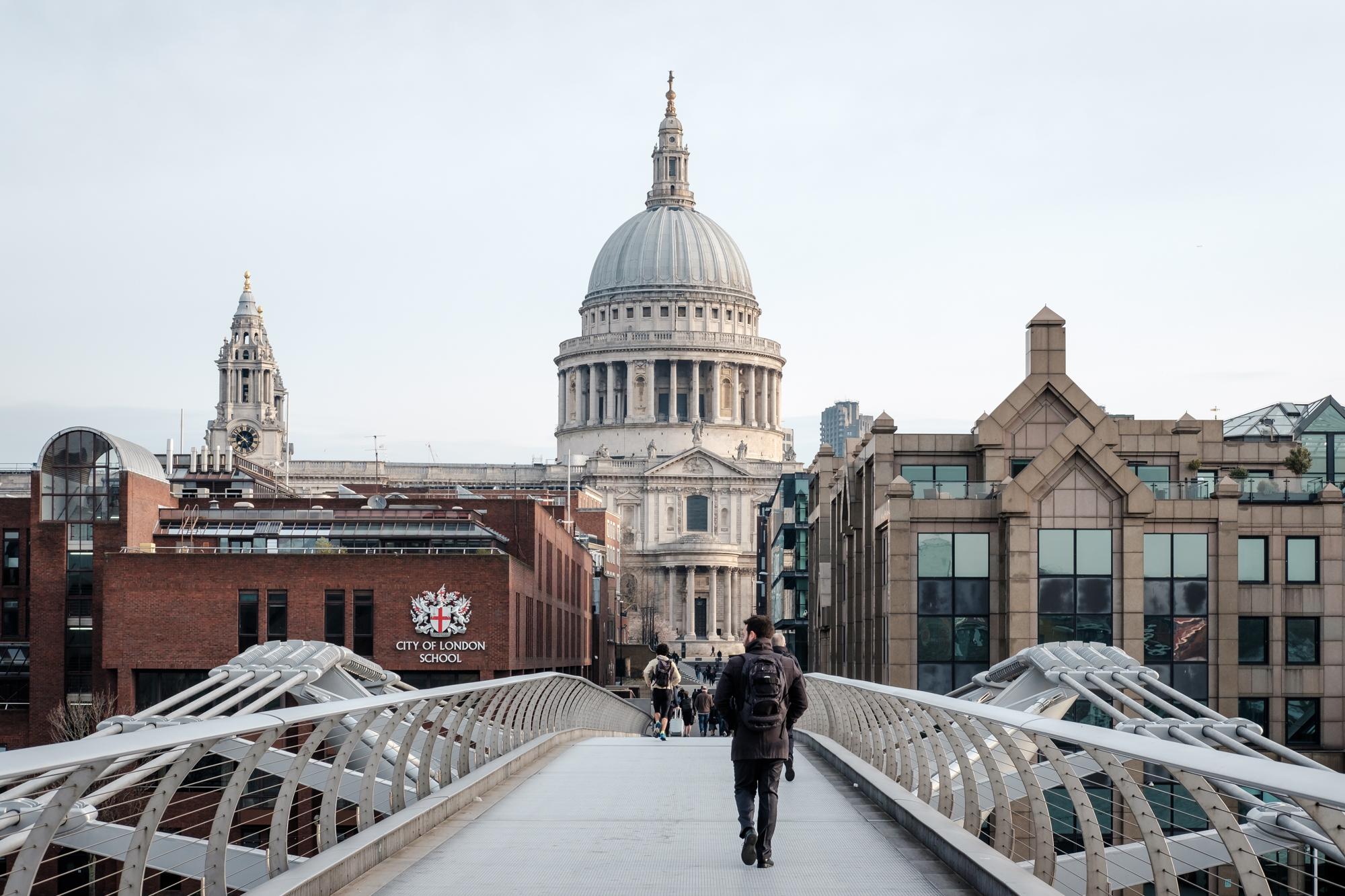 London Chrome photo of a man crossing the Millennium Bridge by Trevor Sherwin