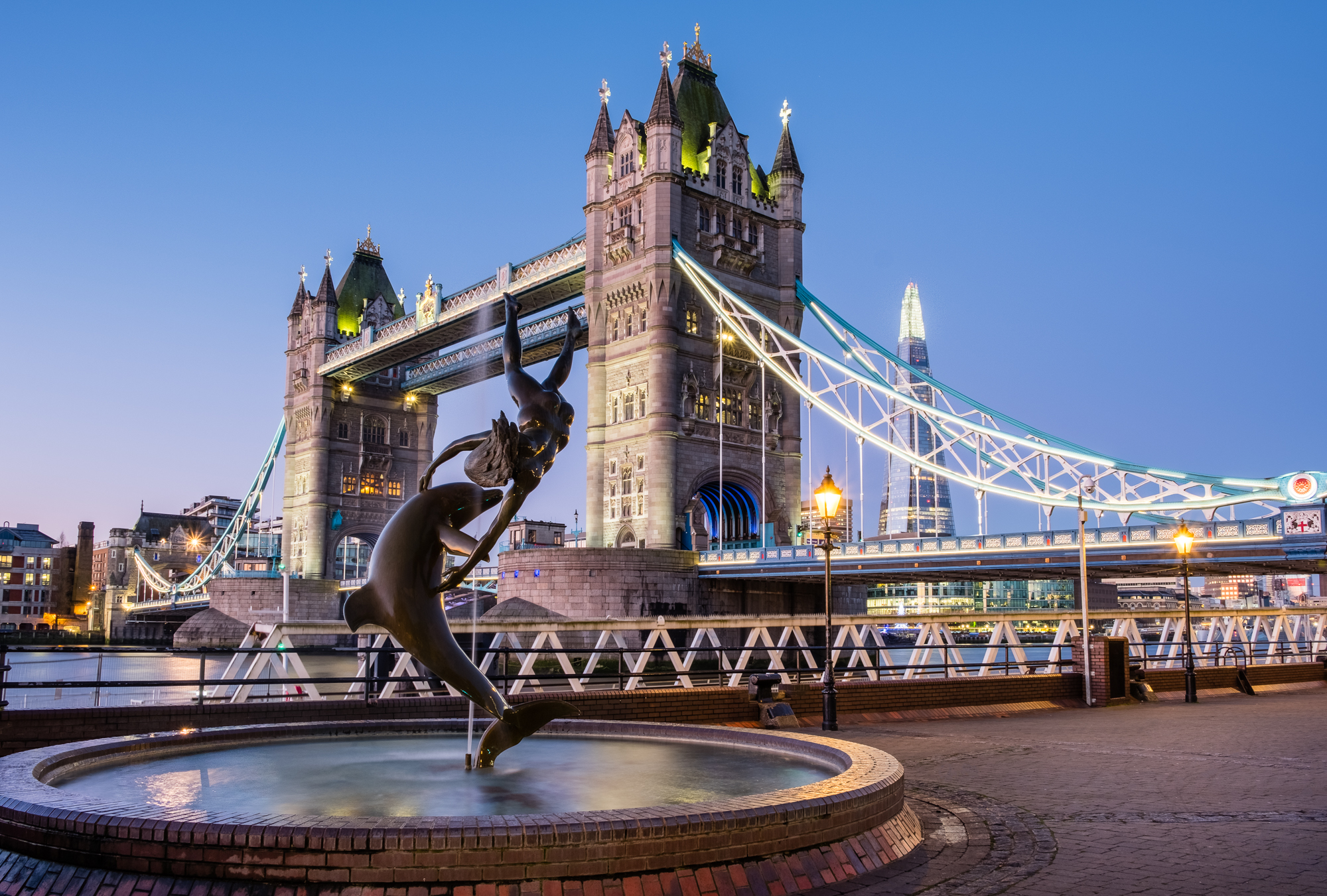 Photo of Tower Bridge and the Girl with the Dolphin by Trevor Sherwin