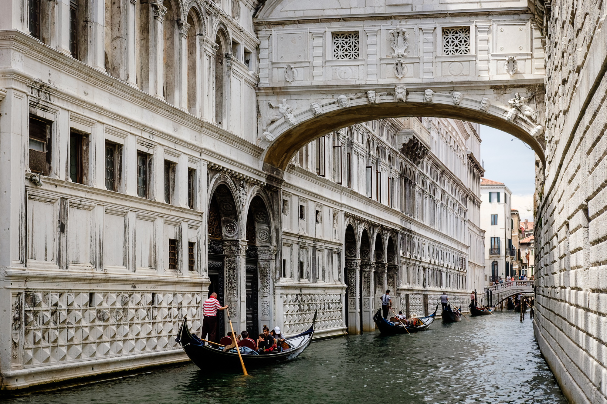 Photo of Gondolas under the Bridge of Sighs in Venice by Trevor Sherwin