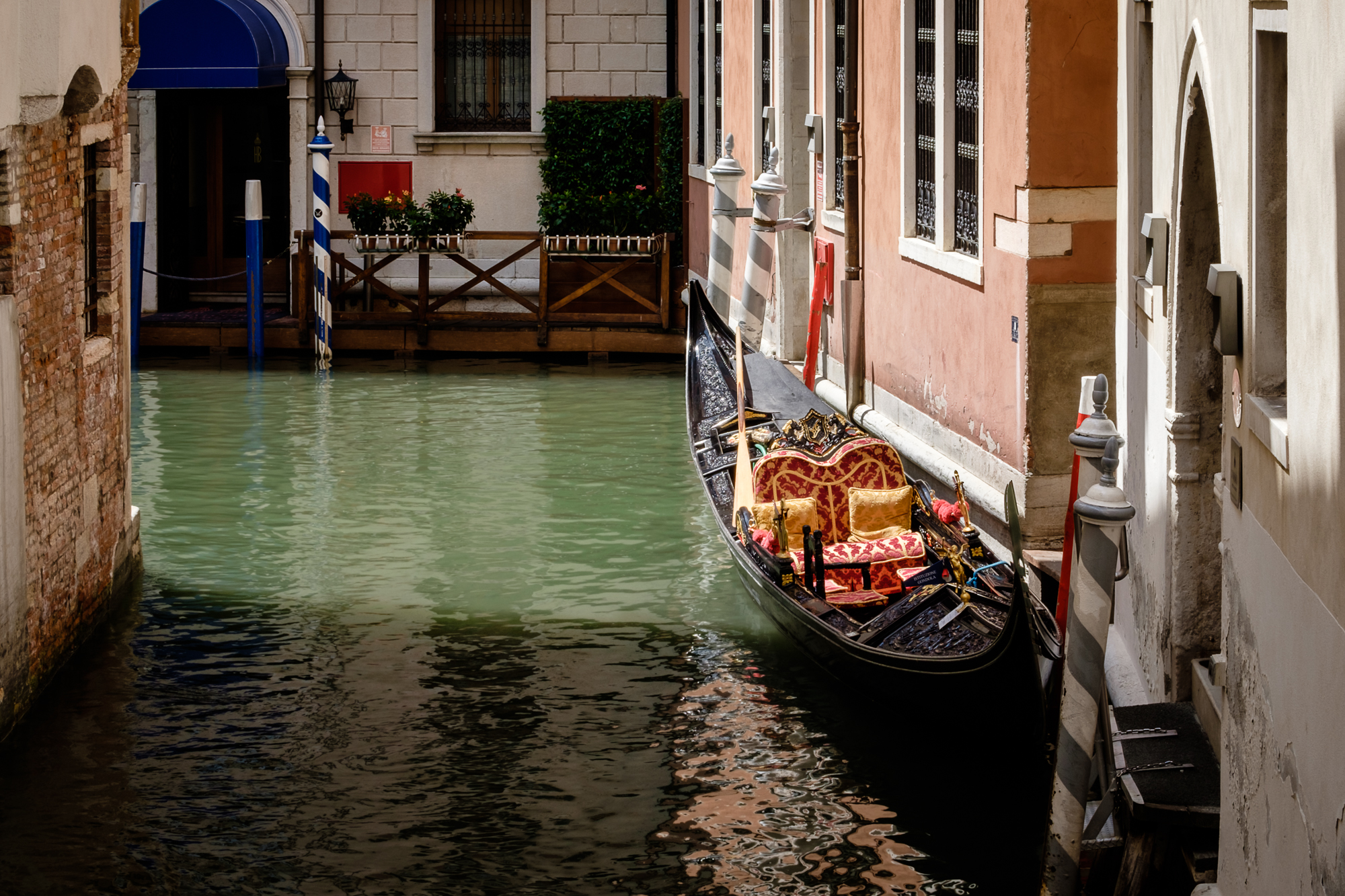 A photo of a moored gondola on the Venetian canal taken by Trevor Sherwin