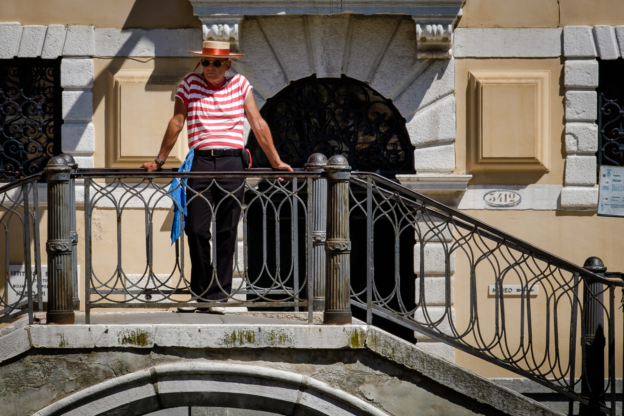 A photo of a Gondolier on a bridge in Venice taken by Trevor Sherwin