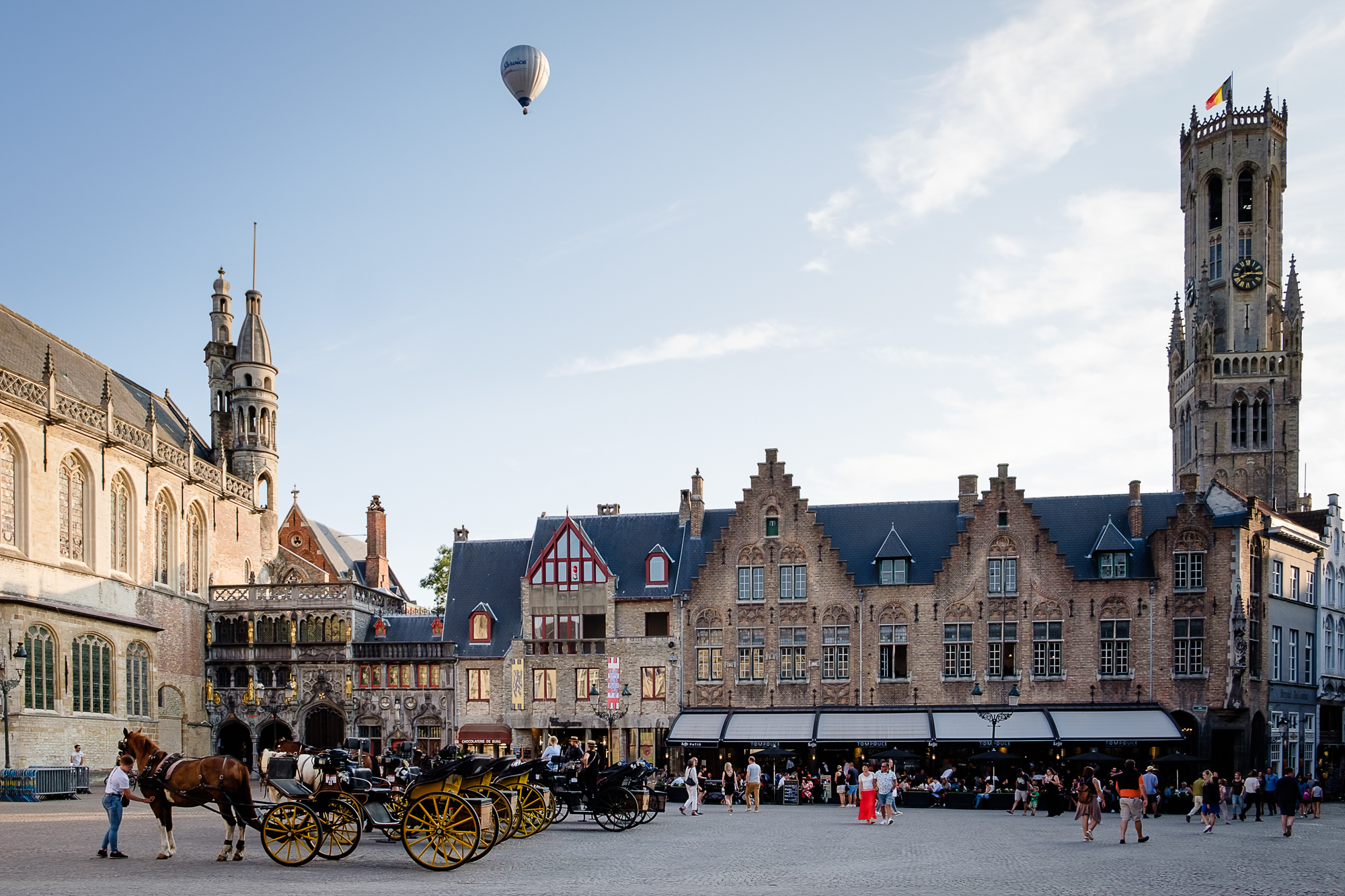 A photo of an air balloon above Burg Square and the Belfry Tower in Bruges, Belgium taken by Trevor Sherwin