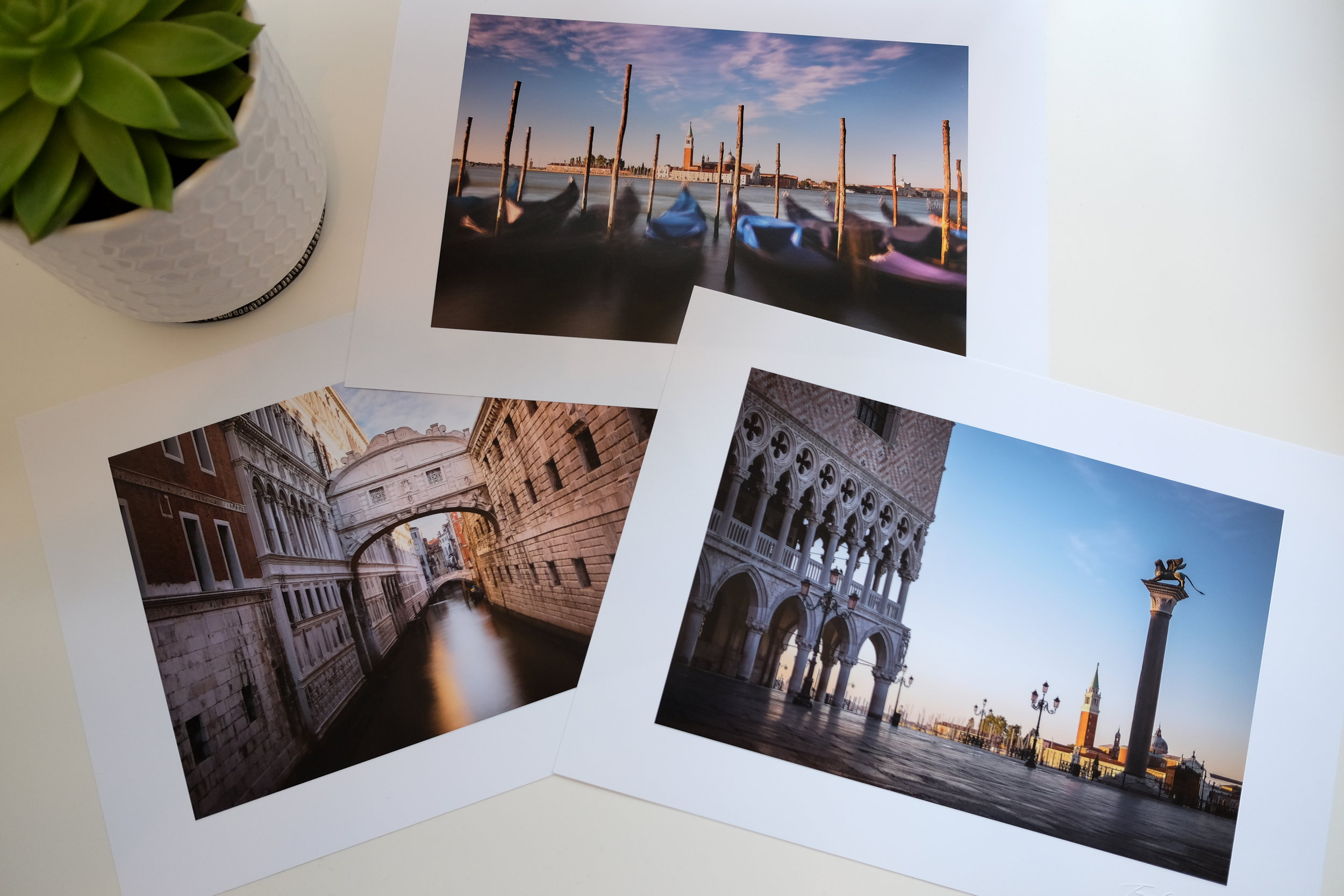Photo of three printed images of Venice by Trevor Sherwin