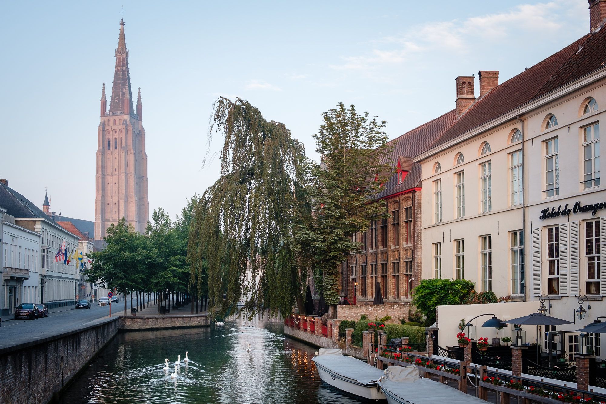 A photo of the Dijver Canal and the Church of our Lady in Bruges, Belgium taken by Trevor Sherwin