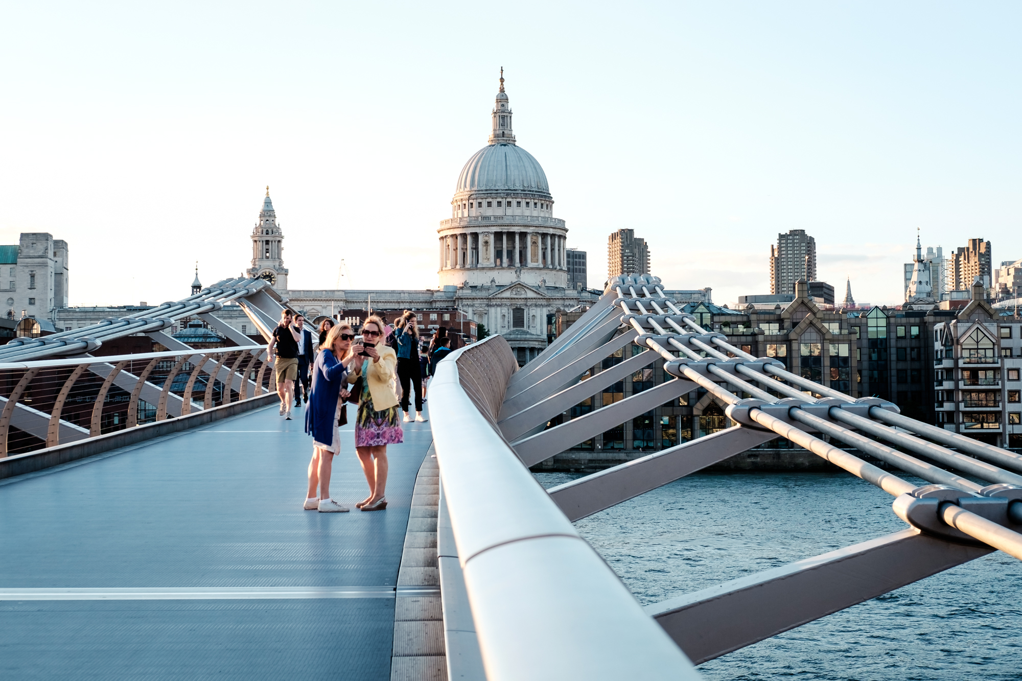 A photo of tourists taking selfies on the Millennium Bridge in London Chrome by Trevor Sherwin