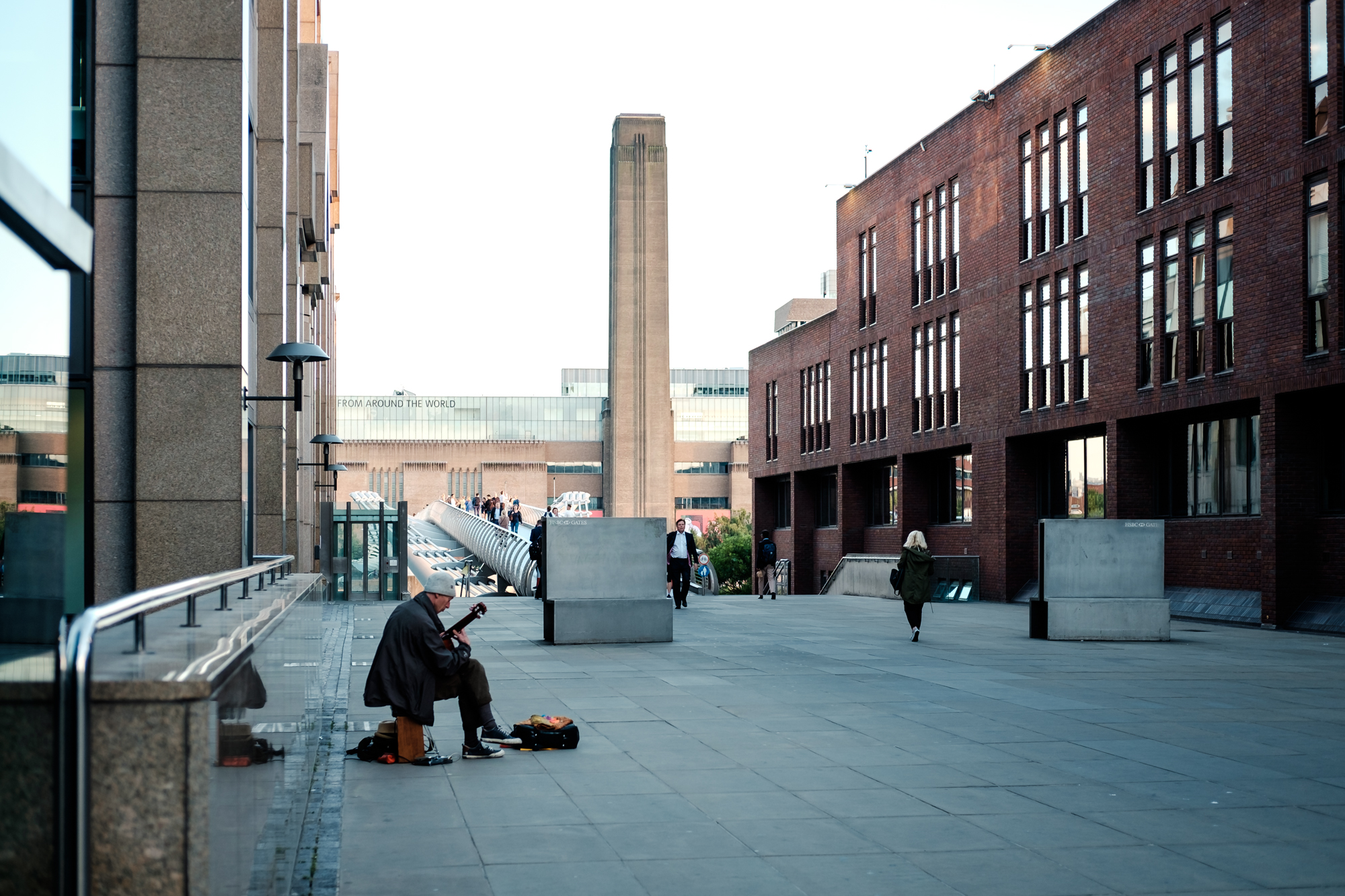 A photo of a busker and Tate Modern in London Chrome by Trevor Sherwin