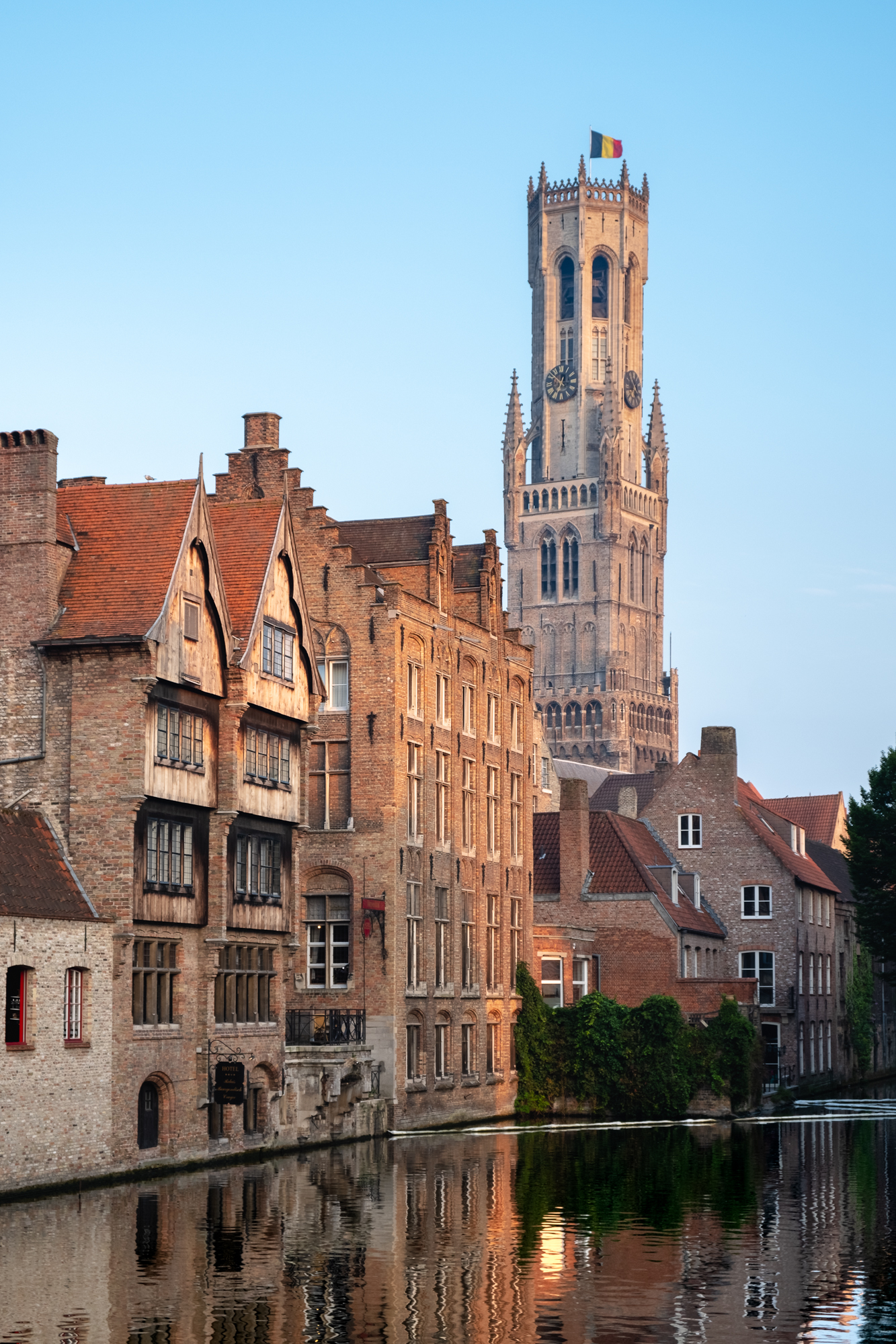 A photo of the Belfry Tower in Bruges from the Dijver Canal in Bruges, Belgium taken by Trevor Sherwin