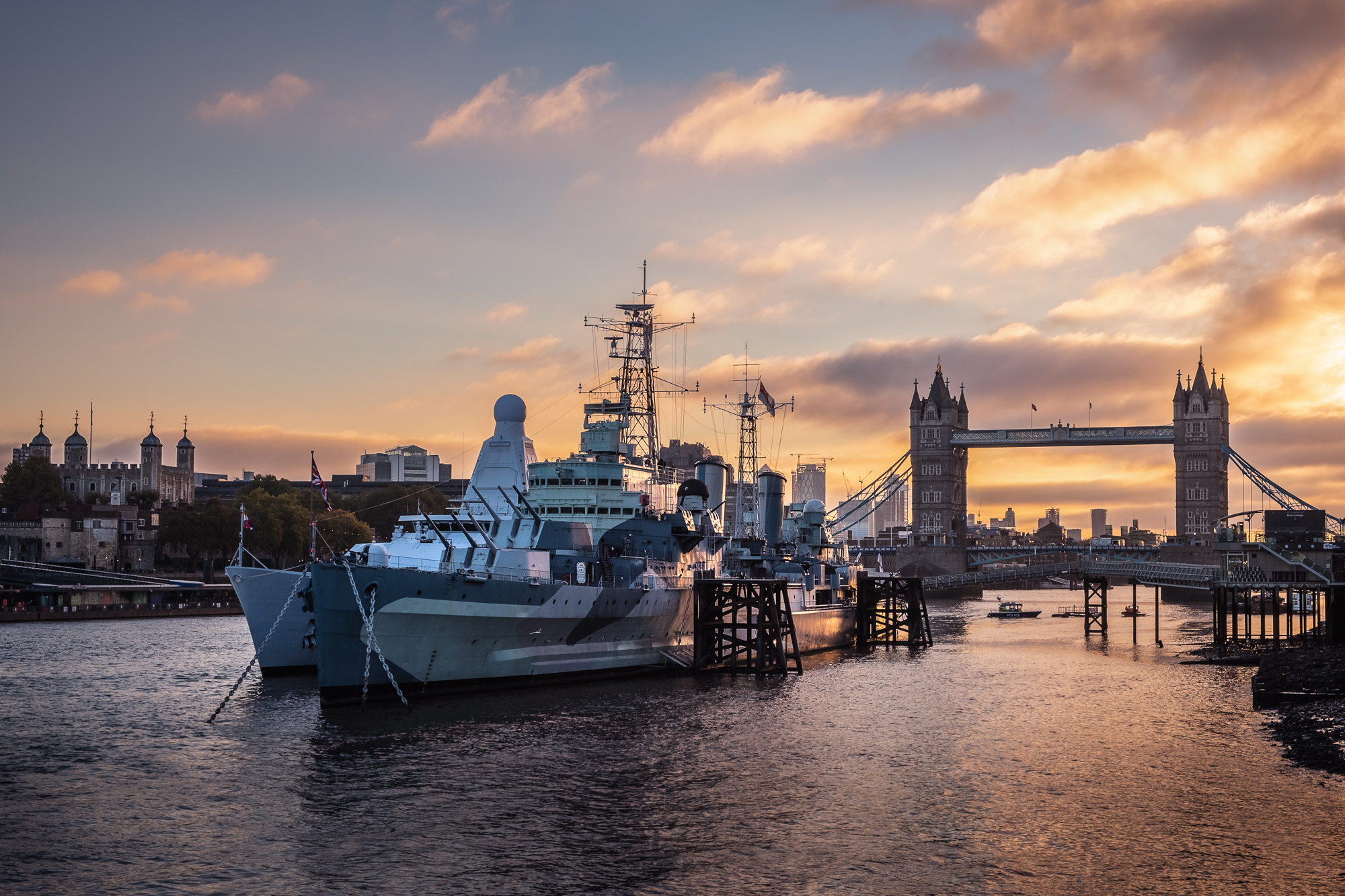 A photo of HMS Belfast and Tower Bridge at sunrise taken by Trevor Sherwin
