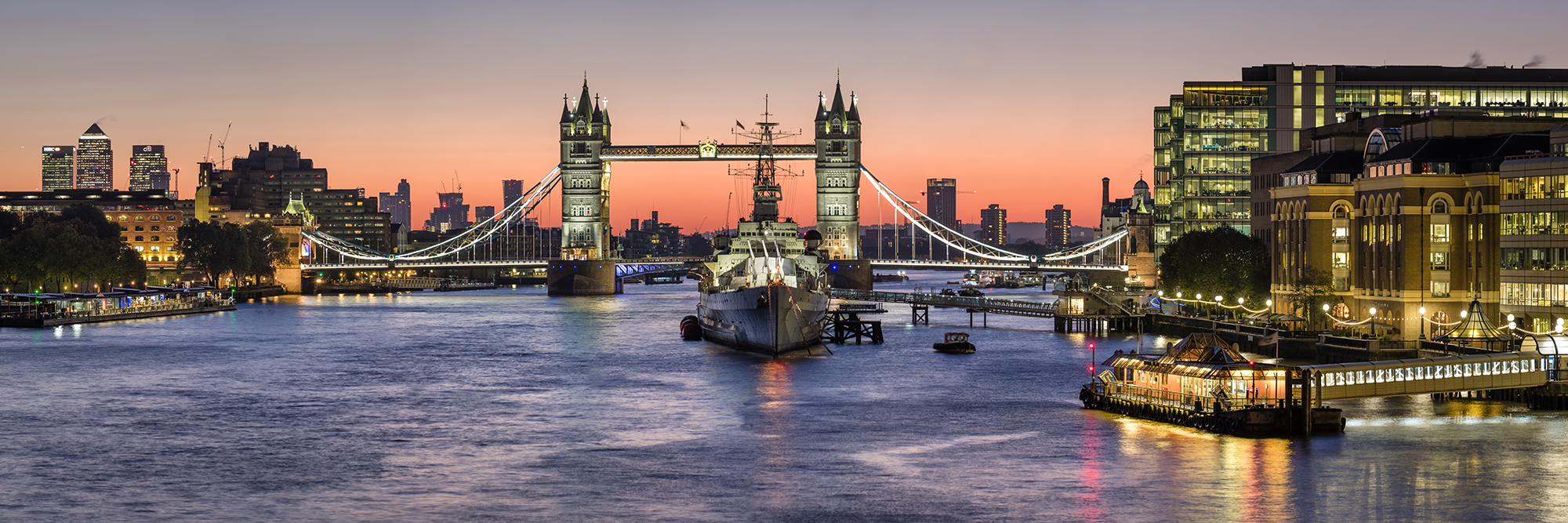A London Panoramic at Sunrise - Tower Bridge and HMS Belfast by Trevor Sherwin