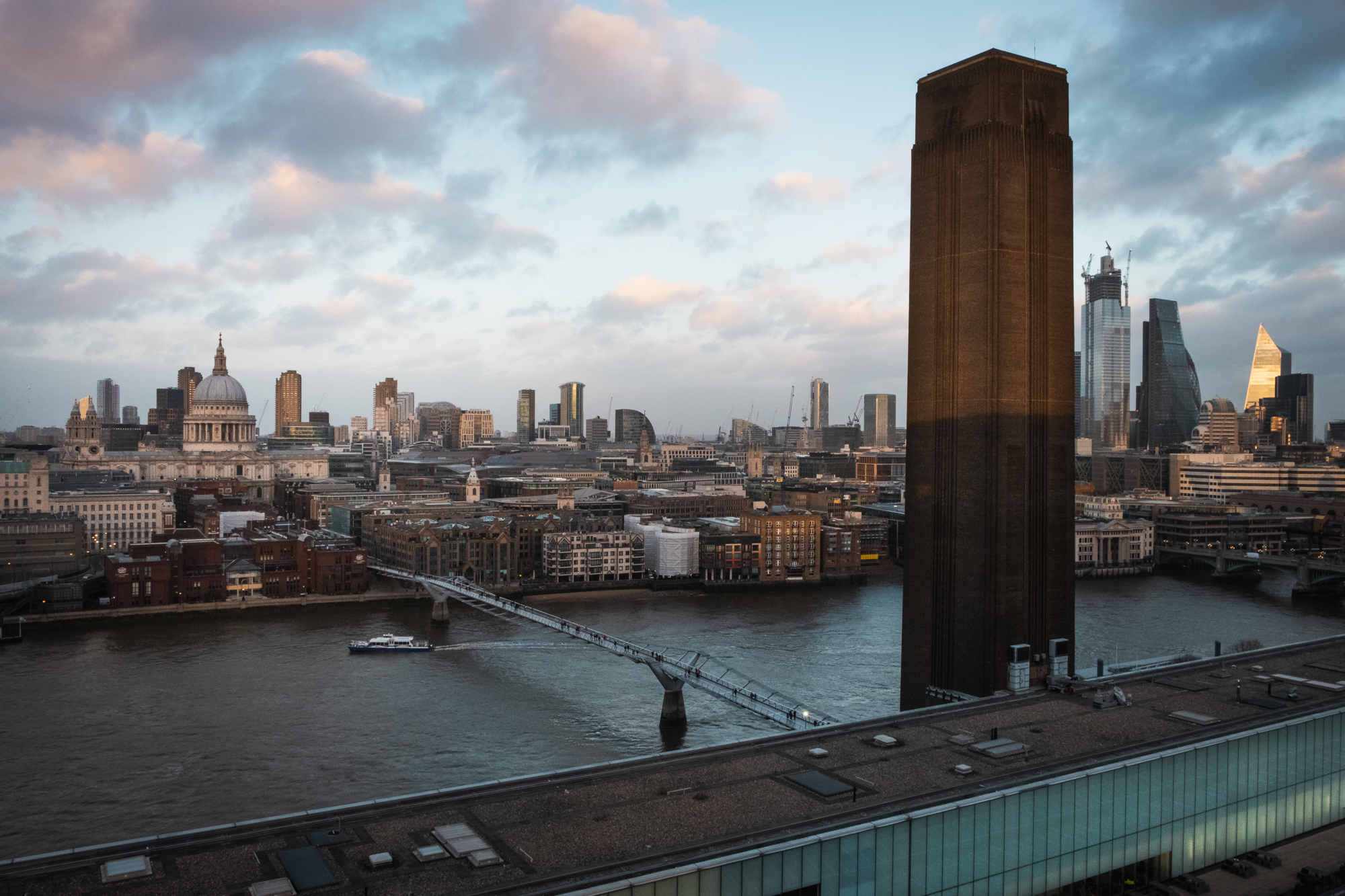 A photo of Tata Modern's chimney and St Pauls Cathedral in London by Trevor Sherwin Photography