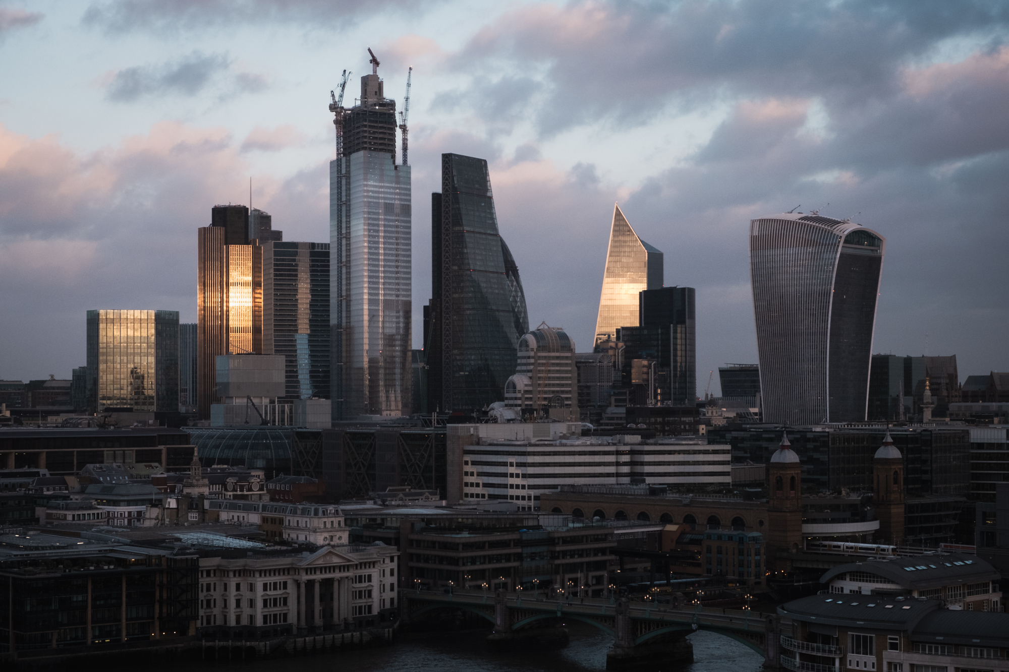 A photo of the sun hitting the city buildings in London by Trevor Sherwin Photography