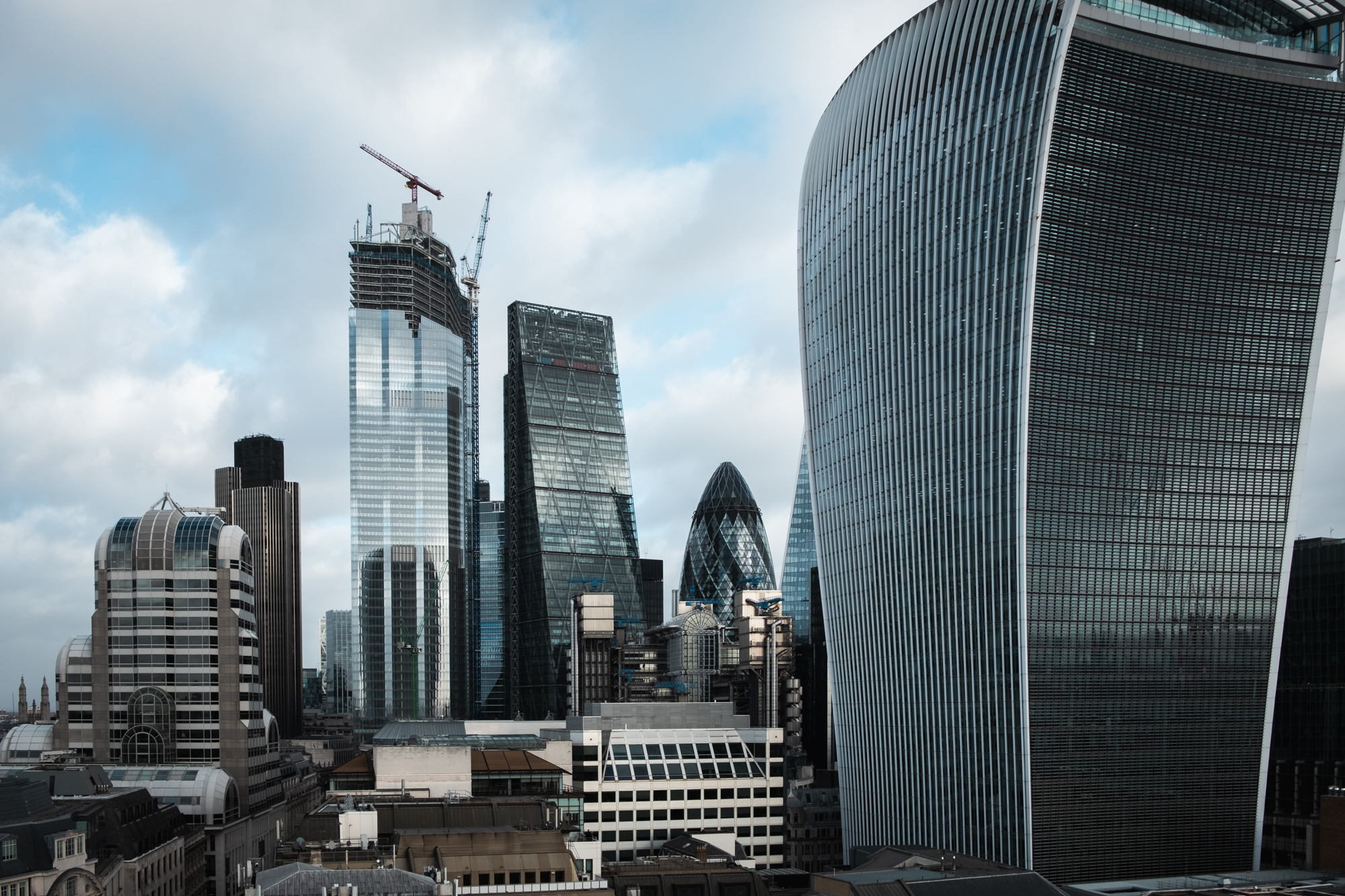 A photo of the city high-rises taken from the top of the Monument in London by Trevor Sherwin Photography
